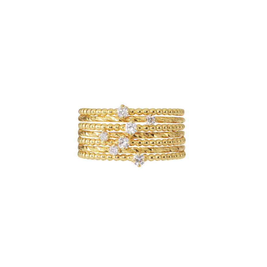 Purist Stacking Set in gold, a combination of baby and lily white diamond rings.