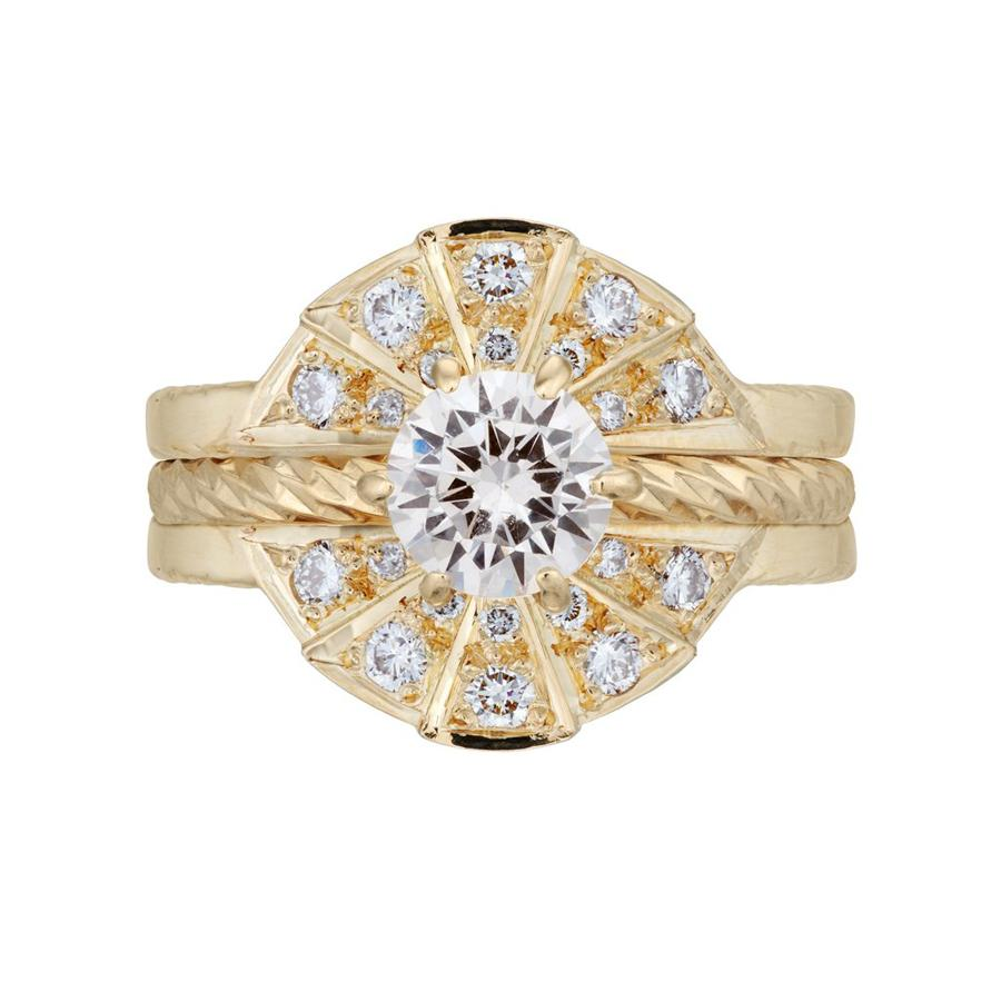 The Rays of Light solitaire engagement ring and white diamond sunbeam wedding band in a full set. Made from 18 carat yellow gold.