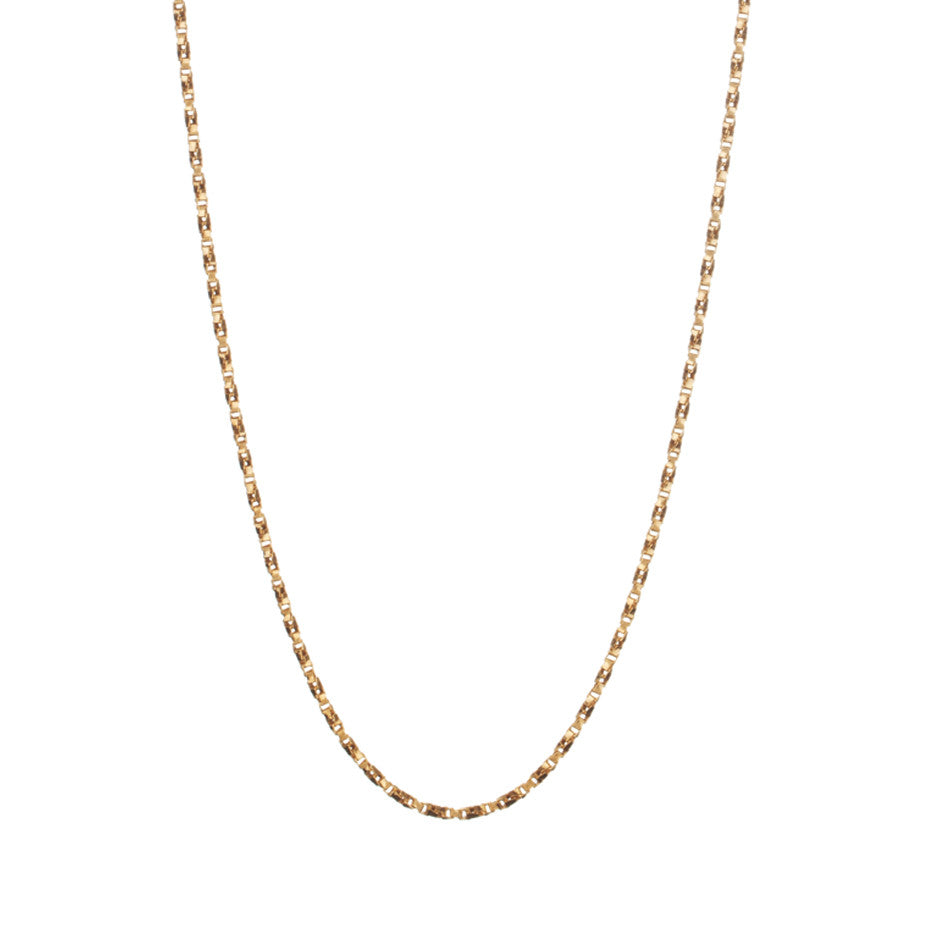 Regal Twist Chain in gold, made from twisted square links that give it a slinky feeling.
