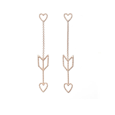 Arrow Of Love earrings in rose gold. The heart and arrow are attached to each other by delicate rose gold chain.