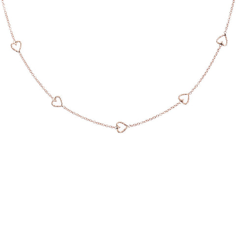The Loop Of Love necklace in rose gold, featuring 5 tiny open hearts.