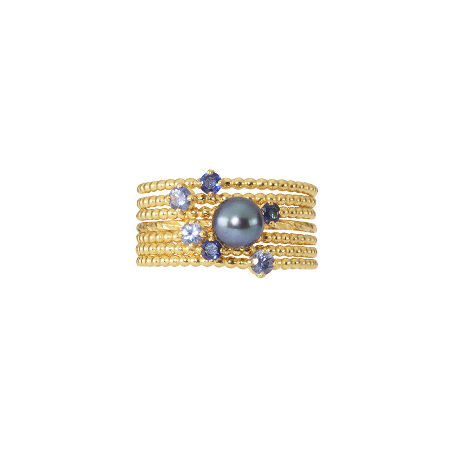 Midnight Stacking Set in gold, combining 3 Forget-Me-Not Blue sapphire rings and 3 Royal Blue sapphire rings together with a Pirate's Black Pearl ring.