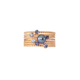 Midnight Stacking Set in rose gold, combining 3 Forget-Me-Not Blue sapphire rings and 3 Royal Blue sapphire rings together with a Pirate's Black Pearl ring.