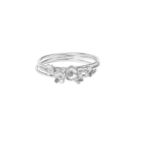 Summer Breeze Flower Stacking rings in silver, made from three rings each decorated with tiny flowers.