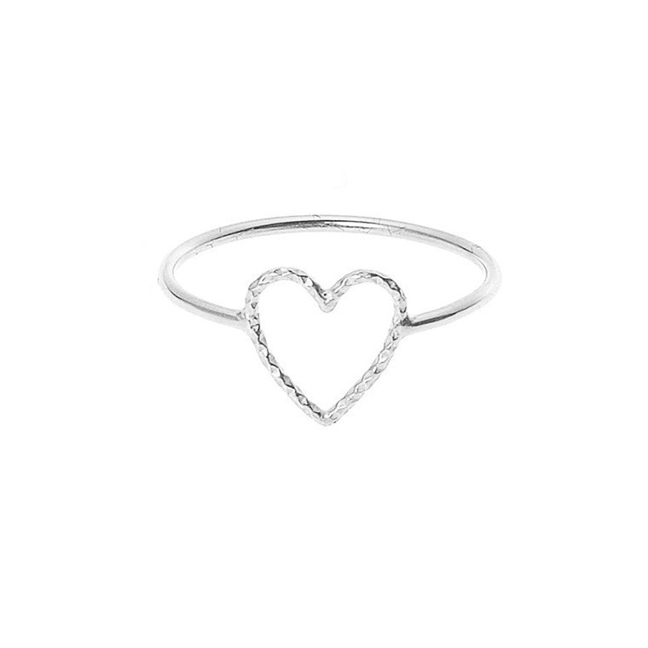 Love Me Tender ring in silver with diamond cut open heart.