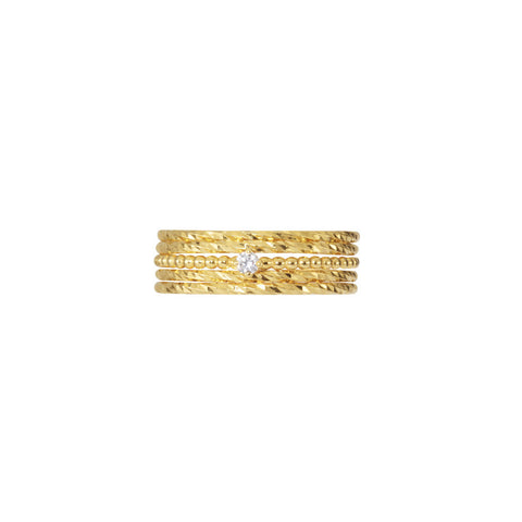 Single Diamond Stacking set in gold, fashioned from beaded and sparkling bands and a white diamond.