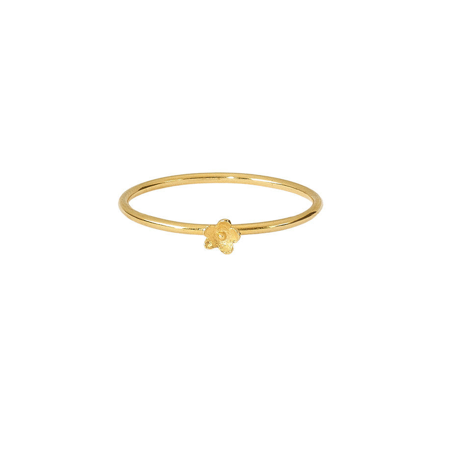 Flower Stacking ring in gold, featuring a smooth band and the prettiest little flower.