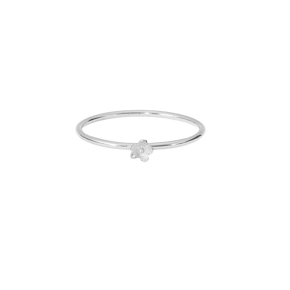 Flower Stacking ring in silver, featuring a smooth band and the prettiest little flower.