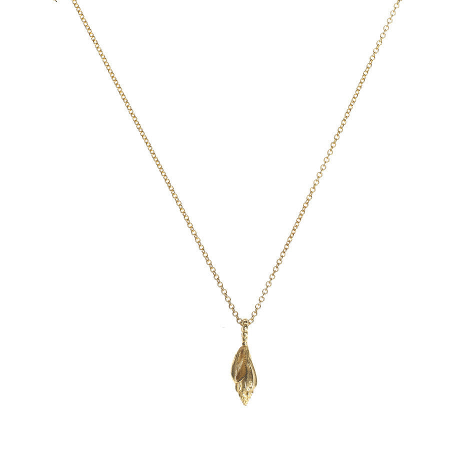 Sound Of The Sea necklace in gold, fashioned from a tiny shell.