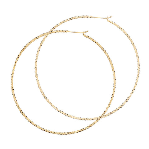 Sparkling Large Hoop earrings in gold, fashioned from our signature diamond cut wire.
