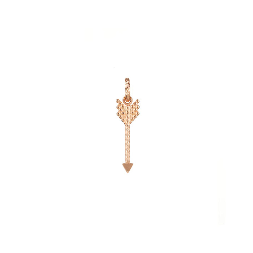Strength Arrow charm in rose gold.