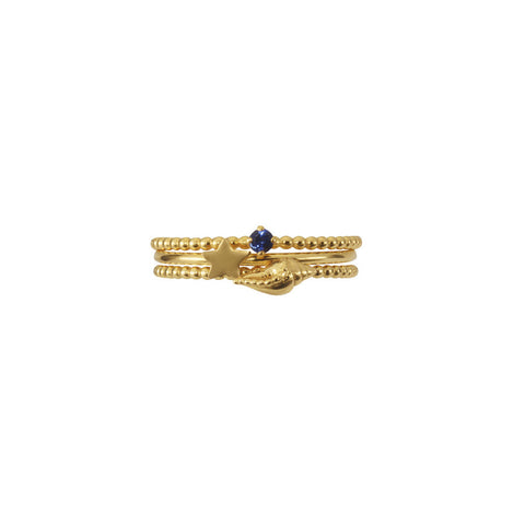 Shell, Star and Sapphire Stacking Trio in gold.