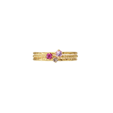 Valentine Stacking Trio in gold, featuring the Pretty in Pink Sapphire, Rose Red Ruby and Champagne Diamond rings.