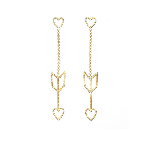 Arrow Of Love earrings in gold. The heart and arrow are attached to each other by delicate gold chain.