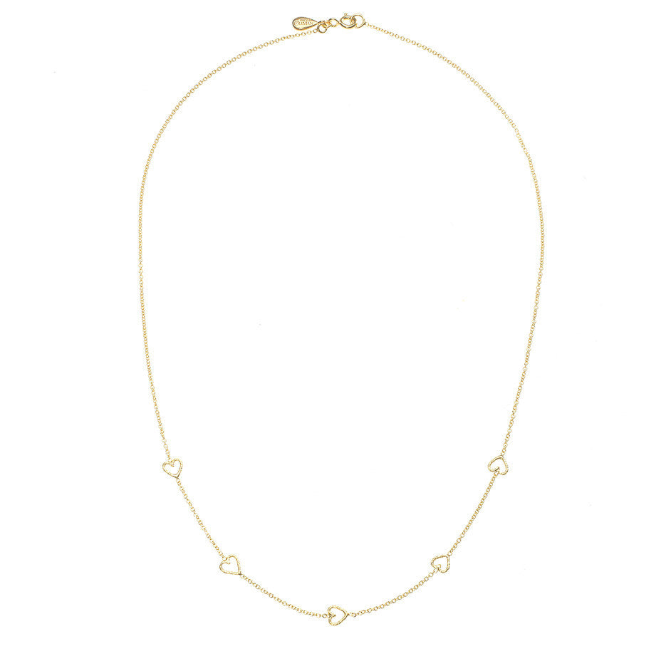 The Loop Of Love necklace in gold, featuring 5 tiny open hearts. Full view.