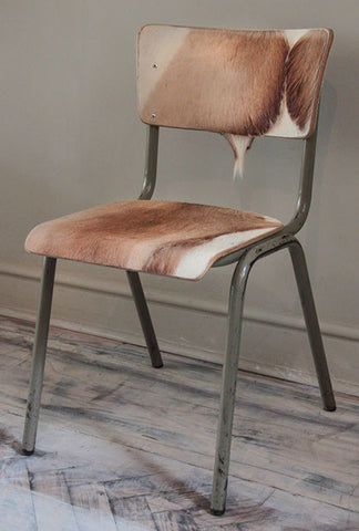 Desk chair covered in hide.