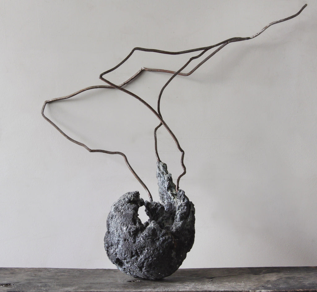 Contemporary sculpture of lava & iron