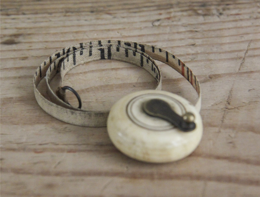 Ivory measuring tape