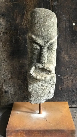 Stone sculpture on a stand