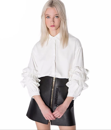 blonde woman modeling Lobby Andy White Ruffle Blouse