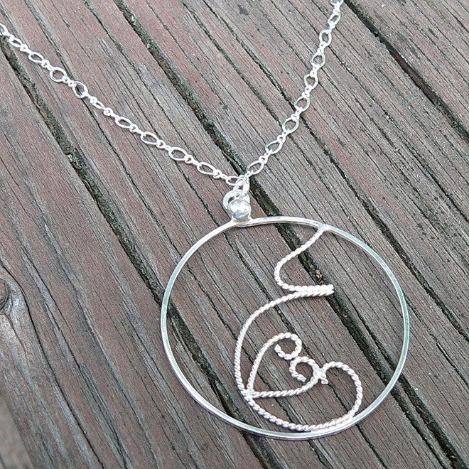 Fluttering Love.  A Pregnancy Necklace.