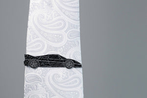 F50 carbon fiber tie clip on a silver tie. Perfect for any car lover.