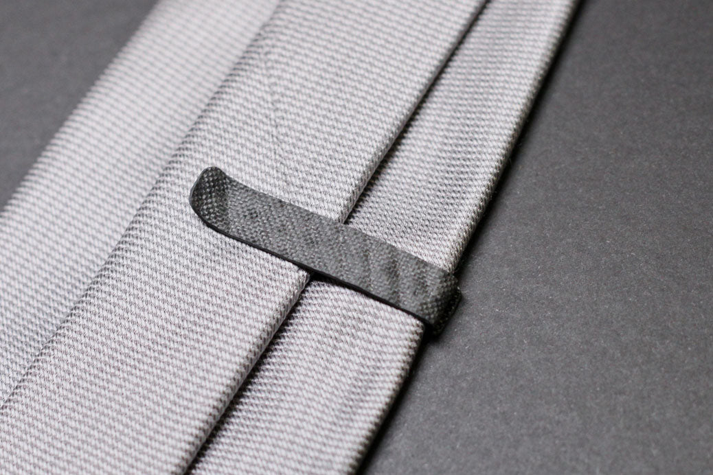 A 959 carbon fiber tie clip, back side on tie