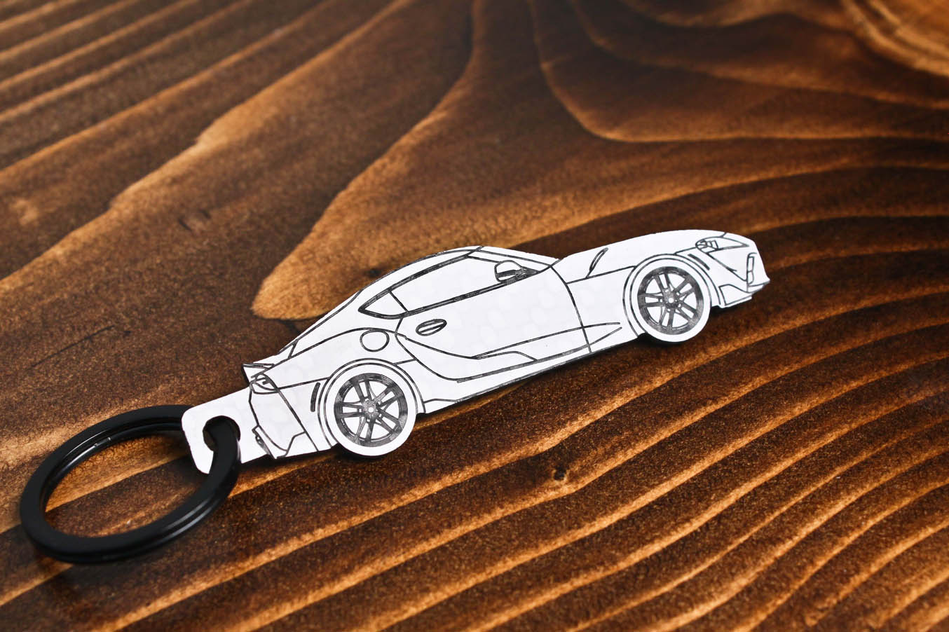 GR Supra carbon fiber keychain reflection