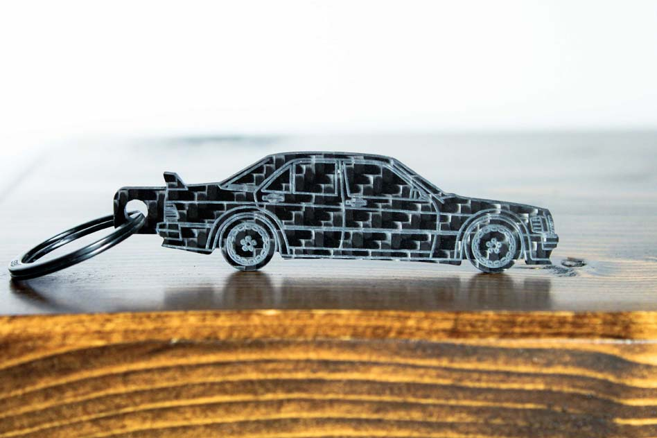 A 190E Evolution 1 carbon fiber keychain, front view