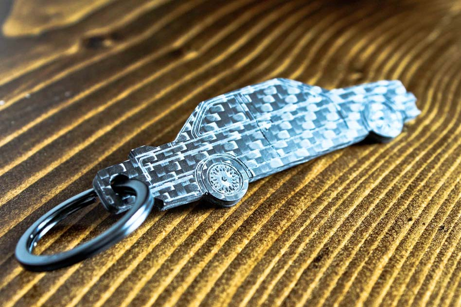 An E30 M3 carbon fiber keychain, angle view