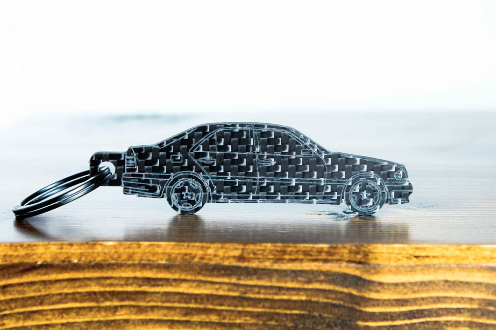 A C36 AMG carbon fiber keychain, front view