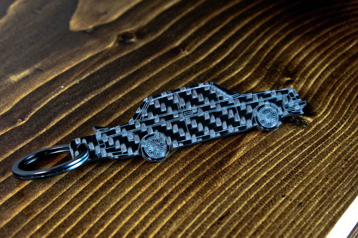 A 242 Turbo Evolution carbon fiber keychain, angle view