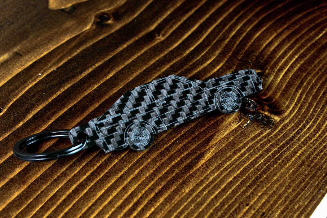 A Sport Quattro carbon fiber keychain, angle view