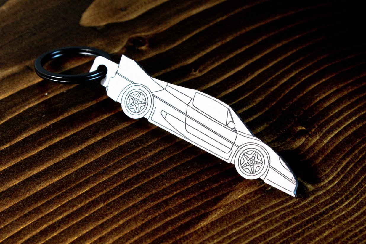An F50 carbon fiber keychain, line detail view