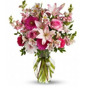 Mixed flowers in pink tones, including roses, lilies and more in Trinidad Tobago.