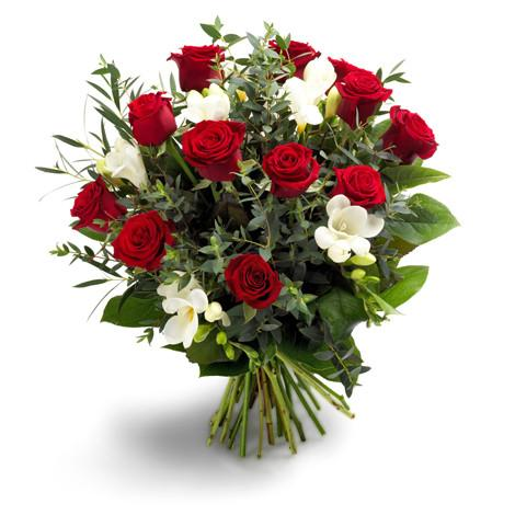 White alstroemerias blooms and red roses arranged perfectly in a round bouquet for Trinidad Tobago.