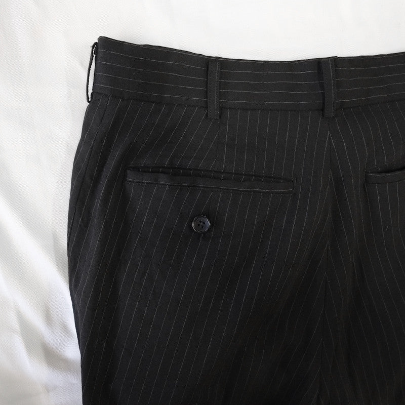 curved pinstripe trousers