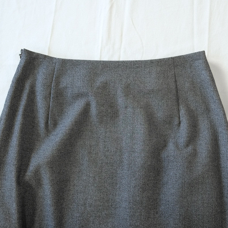 twisted reverse hem skirt