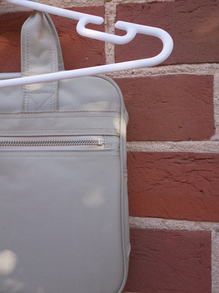 Porter light grey canvas zipped gusset hand bag
