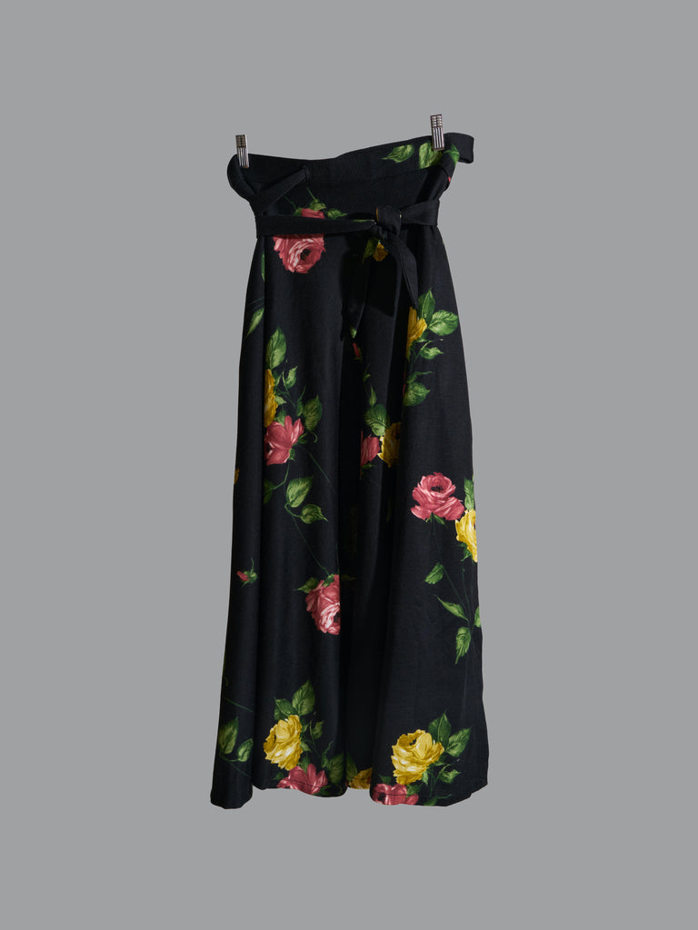vintage 1970s black polyester wrap skirt with red and yellow floral rose print