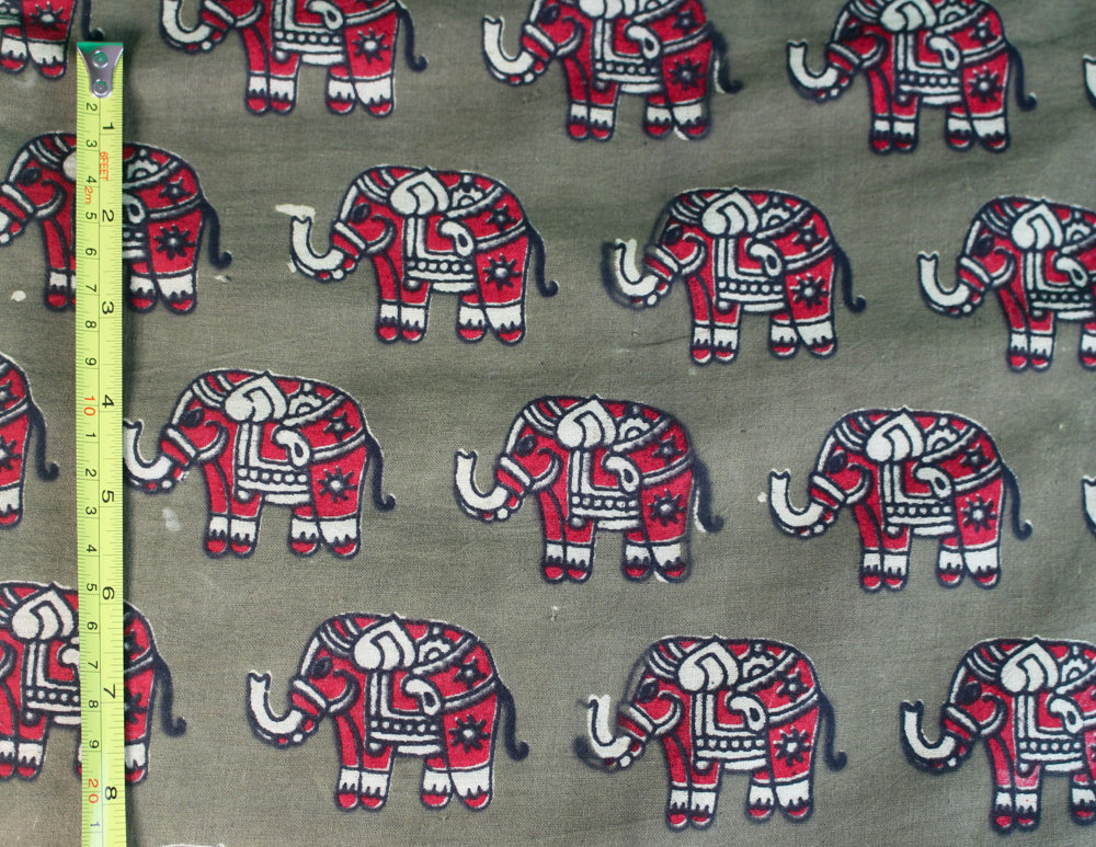 Elephant Herd Secret Pillow in green and red