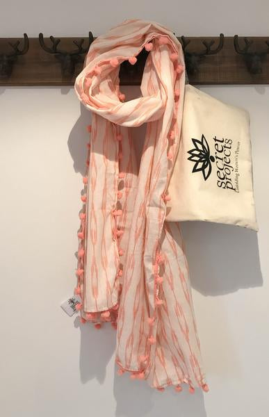 Secret Scarf, Ikkat cream & peach pom-poms