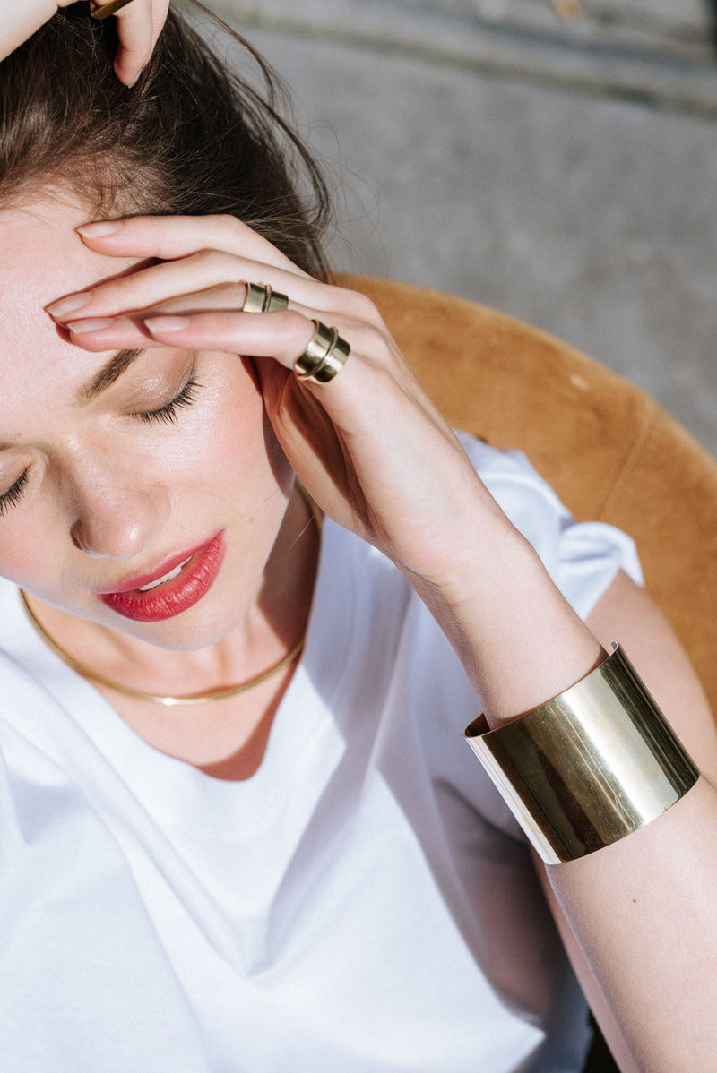 Double Bracelet shown as single brass cuff, close up on a model.