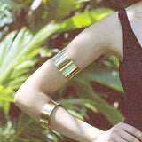 Arm Cuff Big handmade out of Brass on skin close up.