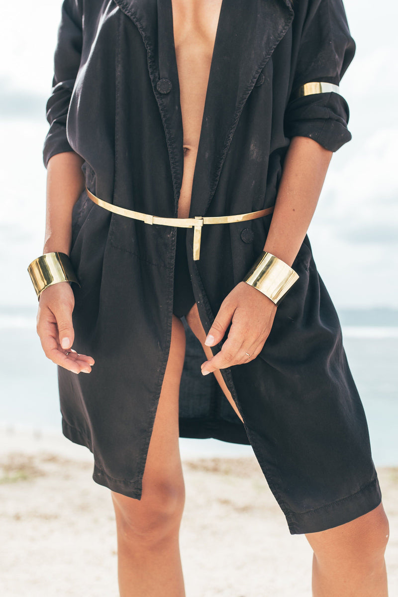 Double Bracelet handmade of Brass. Cool Big Cuffs shown in a beautiful shot near the ocean.