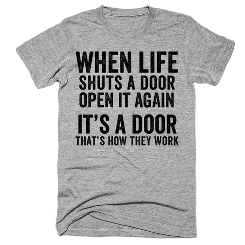 When life shuts a door Open it again It's a door That's how they work t-shirt