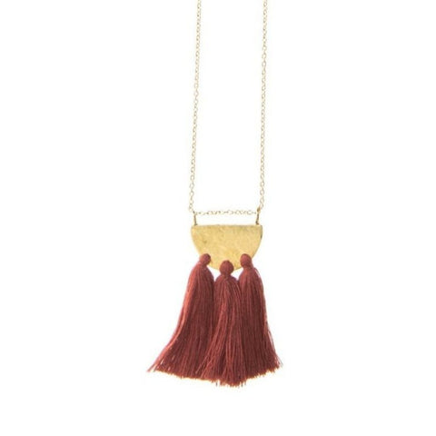 Long Tassel necklace with burgundy fringe and brass semicircle designer details.