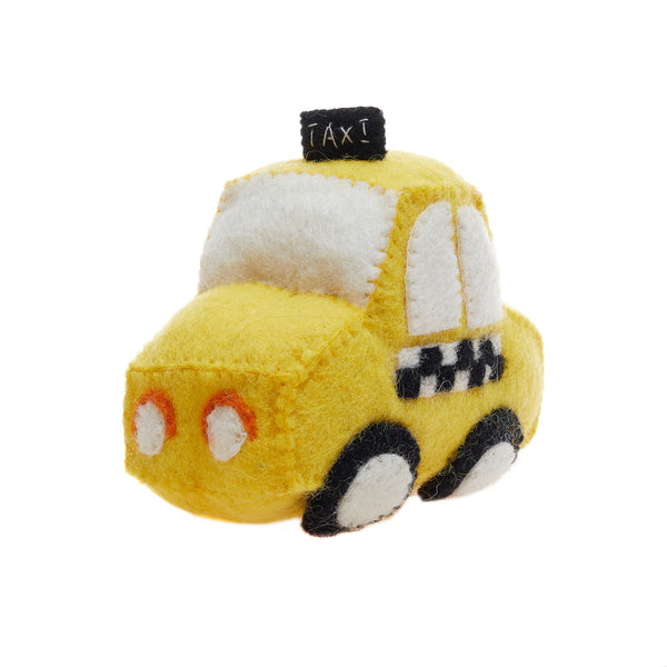 Yellow taxi cab toy made of felt.