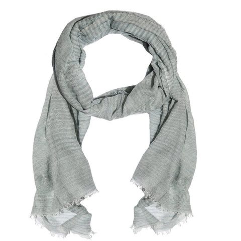 Light blue scarf with subtle stripe pattern. Handwoven in Nepal.