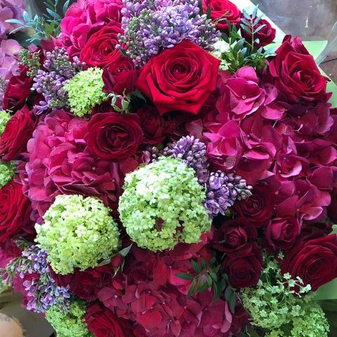 Beautiful bouquet of hydrangeas and red roses